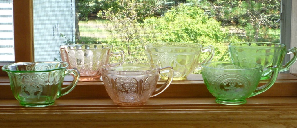 Depression Glass Cups on Parade