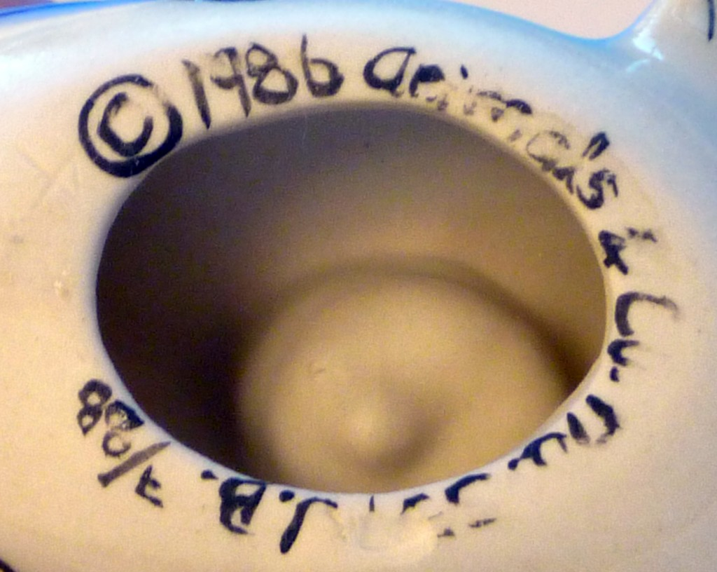 Can You Read This?  Marking on Fish Candle Holder